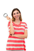 Smiling woman looking into a magnifying glass — Stock Photo