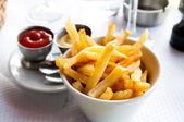 Gouden franse frietjes — Stockfoto