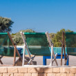 Deckchairs by pool — Stock Photo #11315746