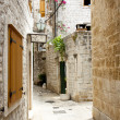 View on narrow alley - Trogir, Croatia. - Stock Photo