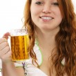 Redhead woman in bavarian dress and a glass with beer — Stock Photo