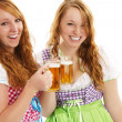 Two happy bavarian girls with beer — Stock Photo