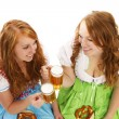 Two bavarian women with beer and pretzels — Stock Photo