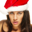 Beautiful christmas woman looking serious — Stock Photo