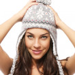 Sweet young brunette woman wearing winter cap — Stock Photo
