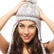 Stock Photo: Sweet young brunette woman wearing winter cap