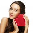 Beautiful woman holding red heart — Stock Photo #10776353