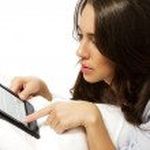 Closeup of a woman reading ebook — Stock Photo #10776379