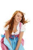 Frau im bayerischen kleid umgang mit wind — Stockfoto