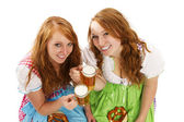 Two bavarian girls with beer and pretzels — Stock Photo