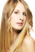 Portrait of a beautiful woman with long blonde hairs — Stock Photo