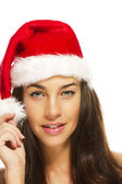 Young beautiful brunette woman wearing santas hat — Stock Photo
