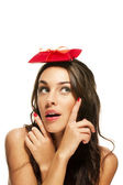 Woman pointing with her fingers to the present on her head — Stock Photo