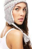 Beautiful woman wearing winter cap looking over her shoulder — Stock Photo