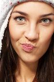 Beautiful brunette woman making puss face — Stock Photo