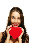 Beautiful smiling woman with a red heart — Stock Photo