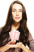 Gorgeous woman presenting poker cards — Stock Photo
