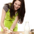 Woman forming dough with her hands — Stock Photo #11129896