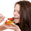 Happy woman eating salad — Stock Photo #11129898
