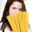 Young woman with spaghetti — Stock Photo