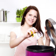 Stock Photo: Womthrowing some waste in trash can