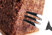 Closeup of a fork in a chocolate cake — Stock Photo
