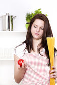 Young woman with spaghetti and tomato — Stock Photo