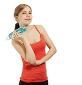 Confident fitness woman with a bottle of water — Stock Photo
