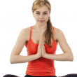 Young woman exercising yoga — Stock Photo