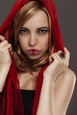 Beautiful woman with a red scarf — Stock Photo