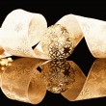 Golden christmas balls with ribbon — Stock Photo