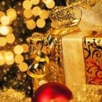 Golden christmas gift — Stock Photo