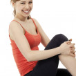 Happy fitness woman making a pause — Stockfoto