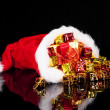 Стоковое фото: Christmas gifts falling from santa's hat