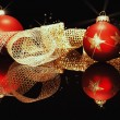 Red christmas balls with golden metal ribbon - Stock Photo