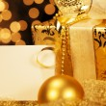 Golden christmas present with christmas balls — Stock Photo