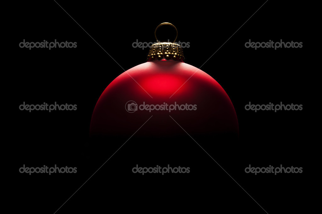Redchristmas ball in tense light on black background — Stock Photo #12274186