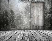 Room interior with old door — Stock Photo