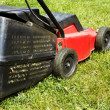 图库照片: Lawnmower on grass
