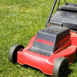 Lawnmower on green grass — Stock Photo
