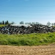 Stock Photo: Silage by farmers using old tires as burden