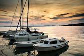 Fishing boats in Adriatic sea with sunset light — Stock Photo