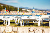 Plastic Sun loungers at beach — Stock Photo