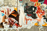 Grunge background with old torn posters — Stock fotografie