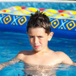 Boy in swimming pool — Foto de Stock