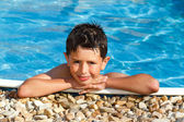 Smiling boy in the swimming pool — Stock Photo