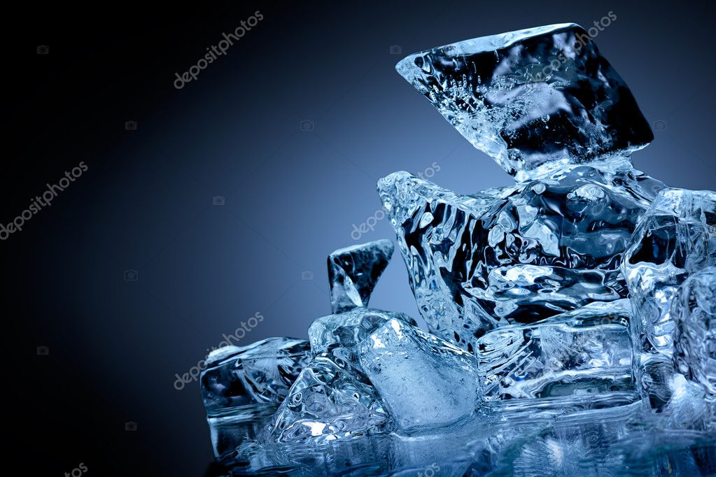 Block of frozen ice with blue toned background. — Stock Photo #11827235