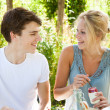 Boy and girl outdoors — Stock Photo