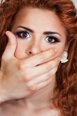 Hand shutting the mouth of the girl — Stock Photo