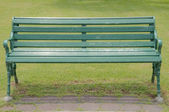 Chair in the park beside walkway — Stock Photo